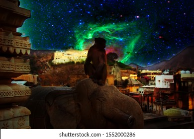 Sacred monkey on background of cosmic starry sky in ancient city. Flying God Hanuman-son of cosmic wind sets fire to hostile island city in Sri Lanka (Ramayana). Elements of image furnished by NASA