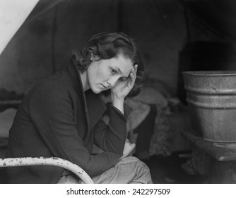 Sad daughter of unemployed Tennessee coal miner in California migrant workers camp near Sacramento, California, during the Great Depression. Photo by Dorothea Lange, 1936.