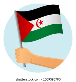 Sahrawi Arab Democratic Republic flag in hand. Patriotic background. National flag of Sahrawi Arab Democratic Republic  illustration