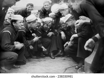 Sailors playing a dice game on the New York, original title: 'Shooting craps on New York', photograph circa 1900s-1930s
