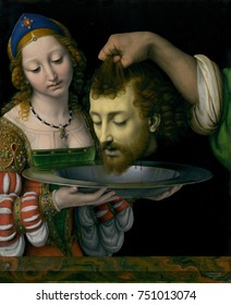 SALOME WITH HEAD OF JOHN THE BAPTIST, by Andrea Solario, 1490-1524, Italian Renaissance oil painting. There is dramatic contrast between Salome\x90s beauty and jewels and Baptists gruesome decapitated