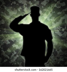Saluting soldier's silhouette on a green army camouflage background
