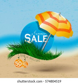 Sammer sale.Caption discount on the blue circle placed on the grass under an umbrella on a background of the sea and the beach