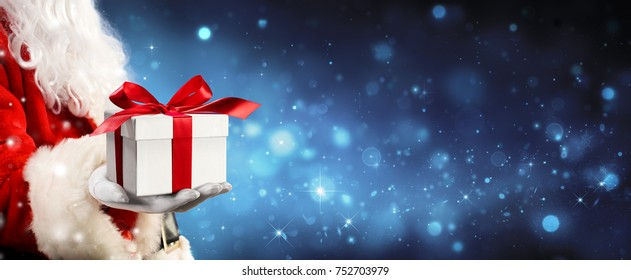 Santa Claus Giving A Giftbox In Magic Night - 3D illustration