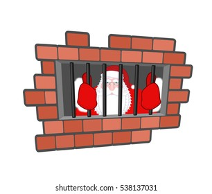 Santa Claus prisoner. Christmas in prison. Window in lockup with bars. Bad man criminal. New year is canceled. Jail break