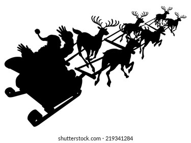 Santa in his Christmas sled or sleigh in silhouette