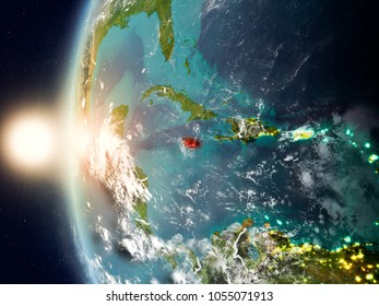 Satellite view of Jamaica highlighted in red on planet Earth with clouds and visible country borders during sunset. 3D illustration. Elements of this image furnished by NASA.