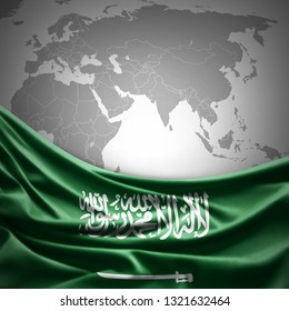 Saudi Arabia flag of silk with copyspace for your text or images and world map background -3D illustration