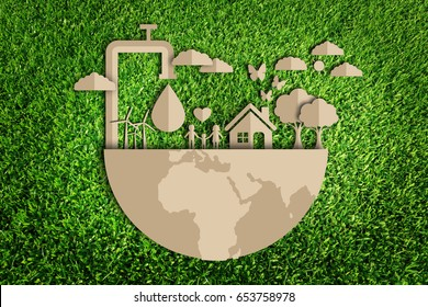 Save water concept. Paper cut of eco on green grass.