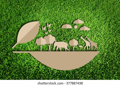 Save the world concept. Paper cut of eco on green grass.