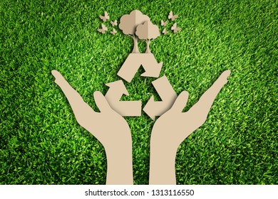 Saving tree. Paper art style of eco on green grass. Reuse, Reduce, Recycle concept. Eco friendly. Save the earth.
