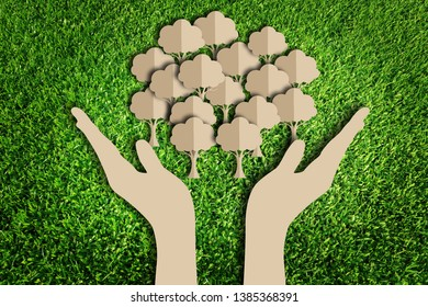 Saving tree. Paper cut of eco on green grass.