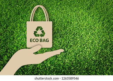 Say no to plastic bags. Paper cut of Eco concept on green grass background