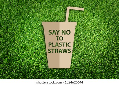 Say no to plastic straws. Paper art style of Eco concept on green grass background. Save the earth.