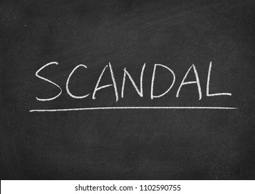 scandal concept word on a blackboard background
