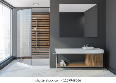Scandinavian style bathroom interior with grey walls, a white wooden floor, a sink with a large mirror above it and a wooden chair. Glass door shower. 3d rendering mock up