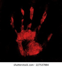 Scary bloody hand print on a black background