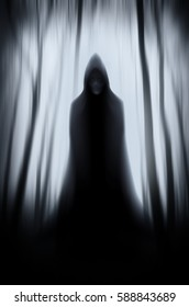 scary ghost in surreal dark Halloween forest landscape