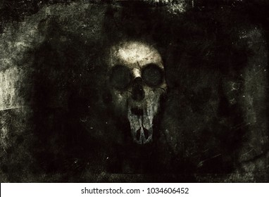 Scary horror grunge wallpaper with spooky skull.  Design for t-shirt print with creepy skull.