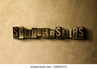 SCHOLARSHIPS - close-up of grungy vintage typeset word on metal backdrop. Royalty free stock illustration.  Can be used for online banner ads and direct mail.