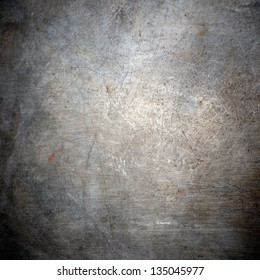 scratched grunge metal plating;  industrial  abstract background