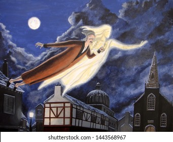 Scrooge and the Ghost of Christmas Past soar over the town on a moonlit Christmas Eve.