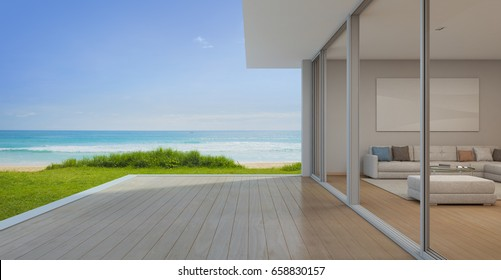 Sea view Living room with empty terrace in modern luxury beach house, Vacation home for big family - 3d rendering of residential building