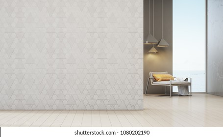Sea view living room of luxury beach house with armchair near window on wooden floor. Empty white triangle pattern wall background in vacation home or holiday villa. Hotel interior 3d illustration.