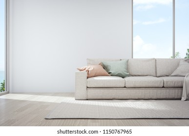 Sea view living room of luxury summer beach house with glass window and wooden floor. Empty white concrete wall background in vacation home or holiday villa. Hotel interior 3d illustration.