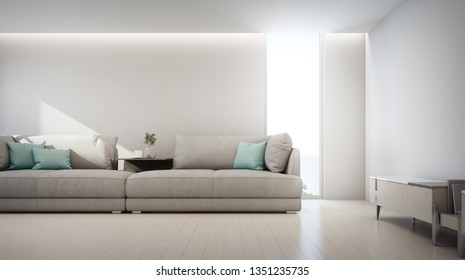 Sea view living room of luxury summer beach house with TV stand and wooden cabinet near big sofa. Empty white wall background in vacation home or holiday villa. Hotel interior 3d illustration.