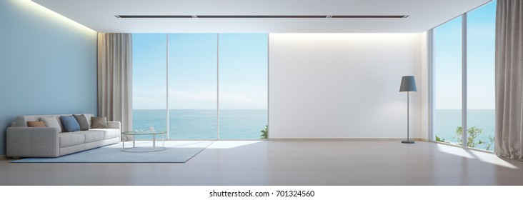 Sea view living room with wooden floor and empty white wall background in luxury beach house, Modern interior of vacation home - Office lounge 3D rendering