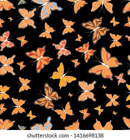 Seamless background of colorful butterflies. Decor on black, white and orange background for clothing design.