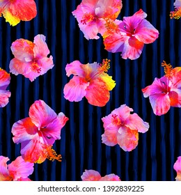 Seamless colorful hibiscos on the watercolor stripes background