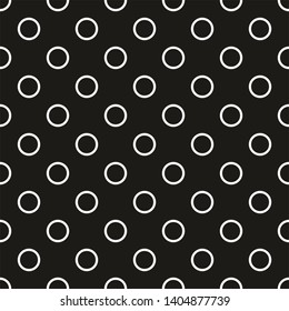 Seamless dark pattern with tile white polka dots on black background
