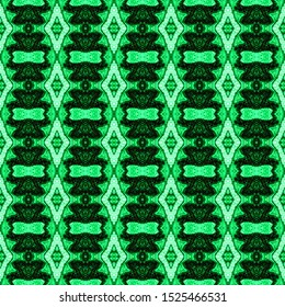 Seamless green embroidery pattern. Ikat ethnic ornament. Seamless striped pattern. Geometric in Aztec style. Figure tribal embroidery. Tribal ethnic texture. Arabian,Scandinavian,Mexican,folk pattern