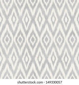 Seamless ikat pattern on paper texture. Traditional background