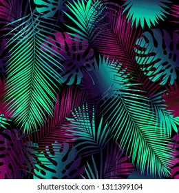 Seamless illustration of tropical leaves. Made in the technique of collage. Tropical leaves of neon flowers on a black background.