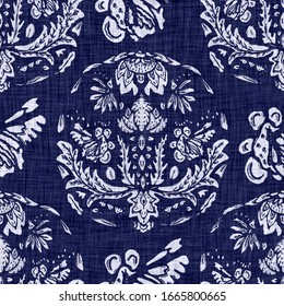 Seamless indigo dyed bandana texture. Blue dark woven cotton effect background. Repeat Indonesian batik resist pattern. White block printed vintage all over textile. Worn handmade boho cloth print