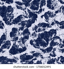 Seamless indigo mottled texture. Blue woven boro cotton dyed effect background. Japanese repeat batik resist  pattern. Distressed tie dye bleach. Asian fusion allover kimono textile. Worn cloth print