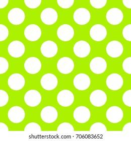 A seamless lime green polka dot background paper pattern.