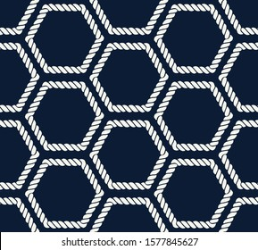 Seamless nautical rope pattern. Endless navy illustration with light cords ornament. Marine hexagon on dark blue backdrop. Trendy maritime style background. For fabric, wallpaper, wrapping