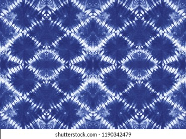 Seamless pattern, abstract tie dyed fabric of indigo color on white cotton. Hand painted fabrics. Shibori dyeing