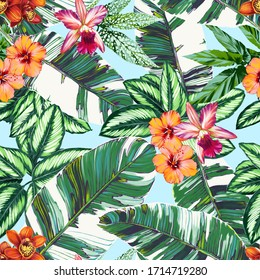 Seamless pattern with banana leaves, orchids, hibiscus flowers and calathea leaves on a blue background. Decorative  botanical exotic illustration wallpaper