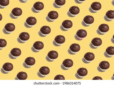 Seamless pattern chocolate cup cake on yellow background. Flat lay illustration homemade bakery for graphic design or wallpapers. Vintage dessert category greeting card for coffee shop.