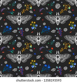 Seamless pattern. Dead head butterfly in night garden. Beautiful wildflowers. Moth among flowers and stones isolated on a black background. Hand drawn illustration for Halloween and more.