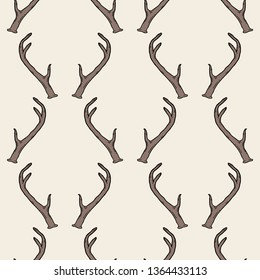 Seamless pattern with deer antlers. Hipster trendy background. Nature wildlife animal light brown backdrop.