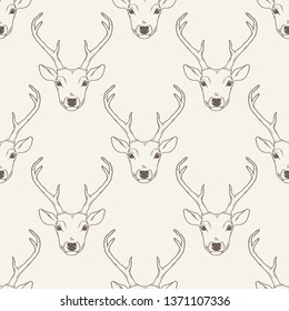 Seamless pattern with deer heads. Hipster trendy background. Nature wildlife animal backdrop in brown over white background.