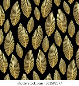 Seamless pattern with gold leaves. . Stylized leaf pattern with gold foil texture on black