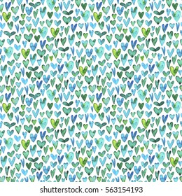 Seamless pattern with green watercolor hearts. Ink illustration. Hand drawn green watercolor. Ornament for wrapping paper. Ornament for Valentine's day.