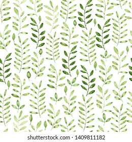 Seamless pattern with leaves in green and light shades. Loose watercolor technique